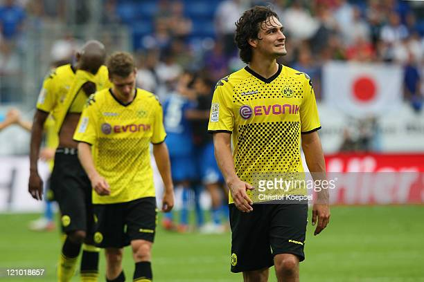 Felipe Santana, Lukasz Piszczek and Mats Hummels of Dortmund look dejected after losing 0-1 the Bundesliga macht between TSG 1899 Hoffenheim and...