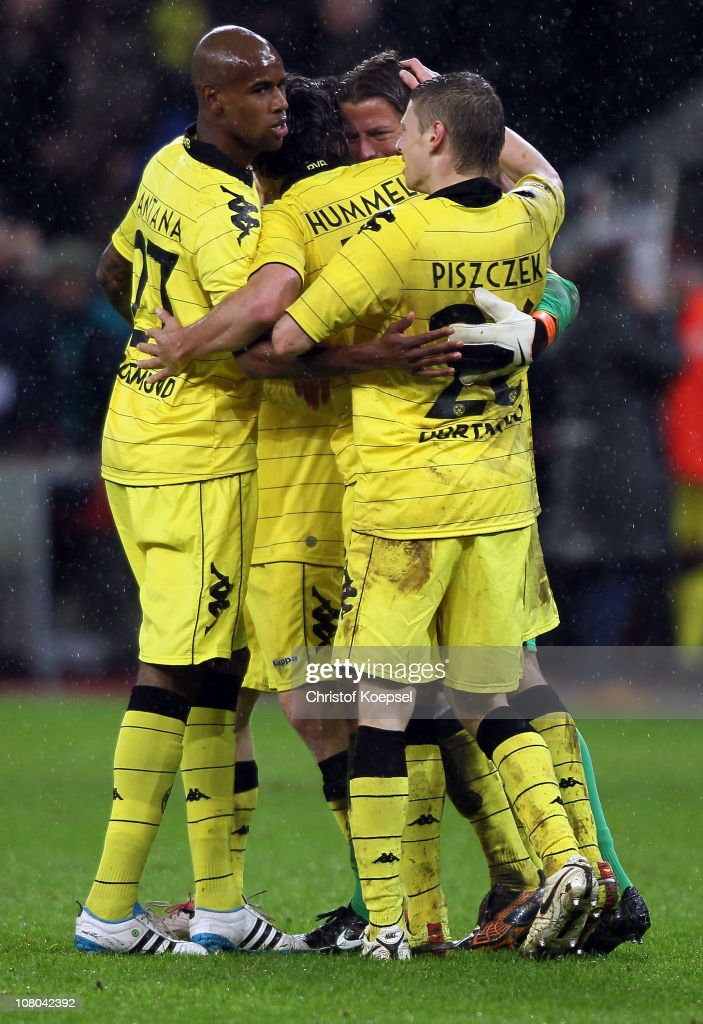 Felipe Santana, Mats Hummels, Roman Weidenfeller and Lukasz Piszczek of Dortmund celebrate the 3-1 victory after the Bundesliga match between Bayer Leverkusen and Borussia Dortmund at BayArena on January 14, 2011 in Leverkusen, Germany.