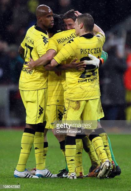 Felipe Santana, Mats Hummels, Roman Weidenfeller and Lukasz Piszczek of Dortmund celebrate the 3-1 victory after the Bundesliga match between Bayer...