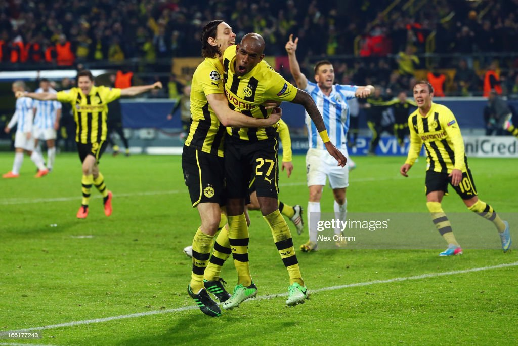 Felipe Santana (R) of Borussia Dortmund celebrates scoring their third and winning goal with team mates Neven Subotic during the UEFA Champions League Quarter Final second leg match between Borussia Dortmund and Malaga at Signal Iduna Park on April 9, 2013 in Dortmund, Germany.