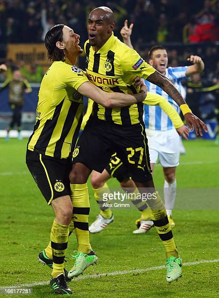 Felipe Santana of Borussia Dortmund celebrates scoring their third and winning goal with team mate Neven Subotic during the UEFA Champions League...