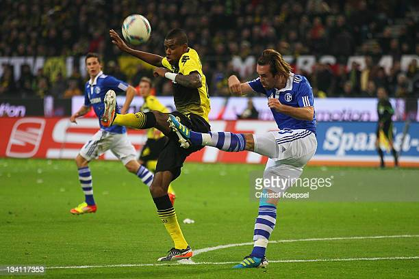 Felipe Santana of Dormtund challenges Christian Fuchs of Schalke during the Bundesliga match between Borussia Dortmund and FC Schalke 04 at Signal...