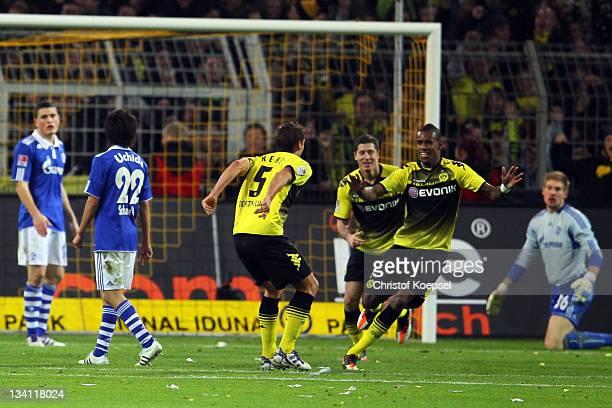 Felipe Santana of Dortmund celebrates the second goal with Robert Lewandowski and Sebastian Kehl of Dortmund during the Bundesliga match between...