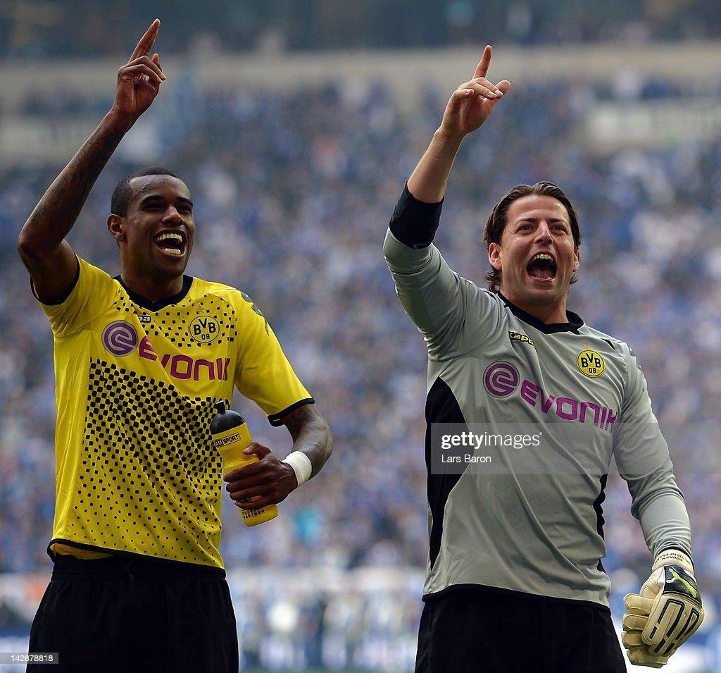Felipe Santana of Dortmund celebrates with team mate Roman Weidenfeller after winning the Bundesliga match between FC Schalke 04 and Borussia Dortmund at Veltins Arena on April 14, 2012 in Gelsenkirchen, Germany.