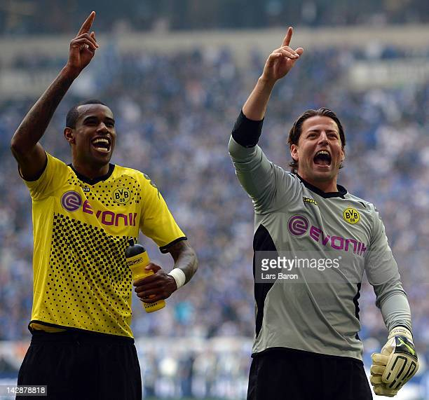 Felipe Santana of Dortmund celebrates with team mate Roman Weidenfeller after winning the Bundesliga match between FC Schalke 04 and Borussia...