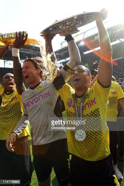 Felipe Santana pours beer over Roman Weidenfeller and Antonio da Silva after winning the German Championships after winning 31 the Bundesliga match...