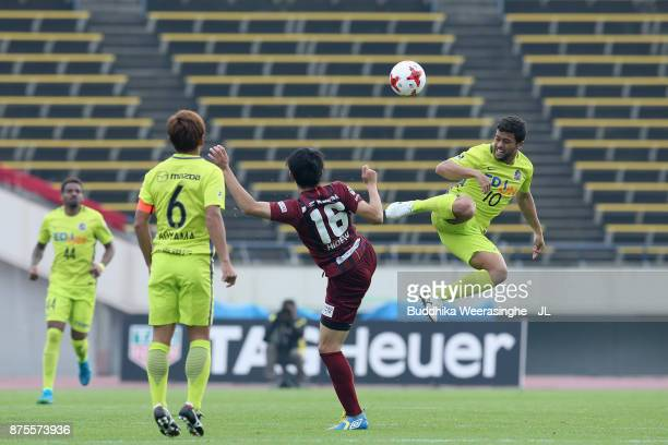 Felipe Silva of Sanfrecce Hiroshima and Hideto Takahashi of Vissel Kobe compete for the ball during the JLeague J1 match between Vissel Kobe and...
