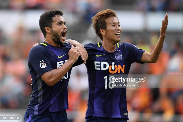 Felipe Silva of Sanfrecce Hiroshima celebrates scoring his side's first goal with his team mate during the JLeague J1 match between Shimizu SPulse...