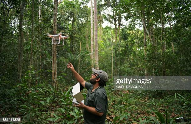 Felipe Spina Avino World Wildlife Fund forestry conservation analyst uses a drone to map an area of rainforest in the Ituxi reserve in the Western...