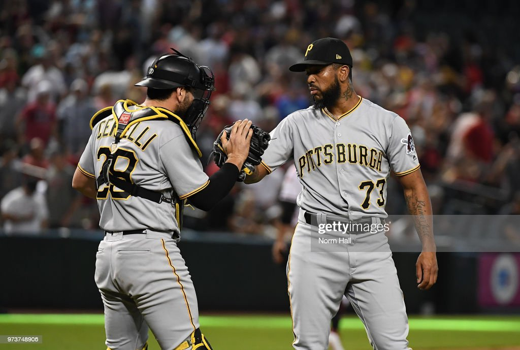 Felipe Vazquez #73 and Francisco Cervelli #29 of the Pittsburgh Pirates celebrate a 5-4 win against the Arizona Diamondbacks at Chase Field on June 13, 2018 in Phoenix, Arizona.