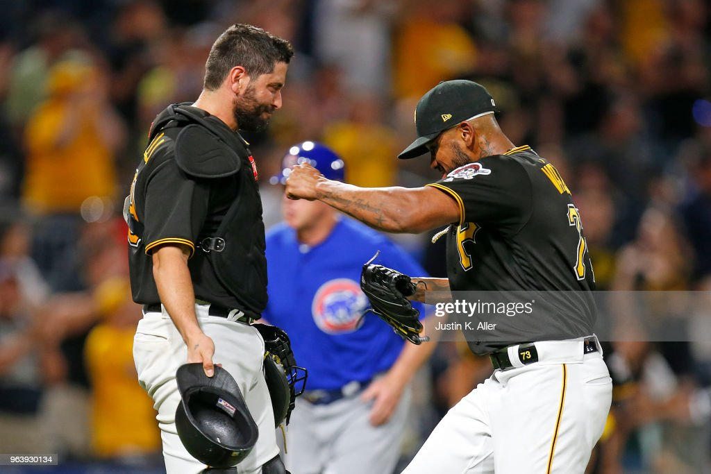 Felipe Vazquez #73 of the Pittsburgh Pirates celebrates with Francisco Cervelli #29 after defeating the Chicago Cubs 2-1 at PNC Park on May 30, 2018 in Pittsburgh, Pennsylvania.