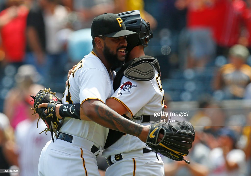 Felipe Vazquez #73 of the Pittsburgh Pirates celebrates with Francisco Cervelli #29 of the Pittsburgh Pirates after defeating the \n 2-0 at PNC Park on July 11, 2018 in Pittsburgh, Pennsylvania.