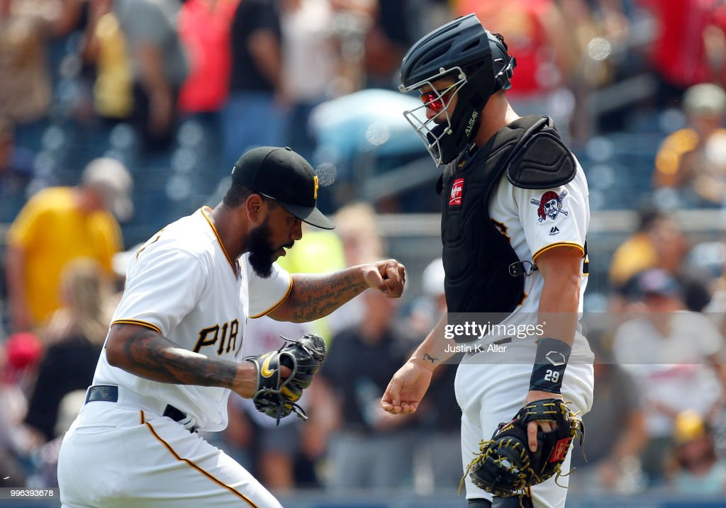 Felipe Vazquez #73 of the Pittsburgh Pirates reacts with Francisco Cervelli #29 of the Pittsburgh Pirates after defeating the \n 2-0 at PNC Park on July 11, 2018 in Pittsburgh, Pennsylvania.