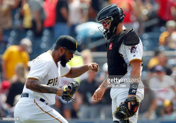 Felipe Vazquez of the Pittsburgh Pirates reacts with Francisco Cervelli of the Pittsburgh Pirates after defeating the n 20 at PNC Park on July 11...