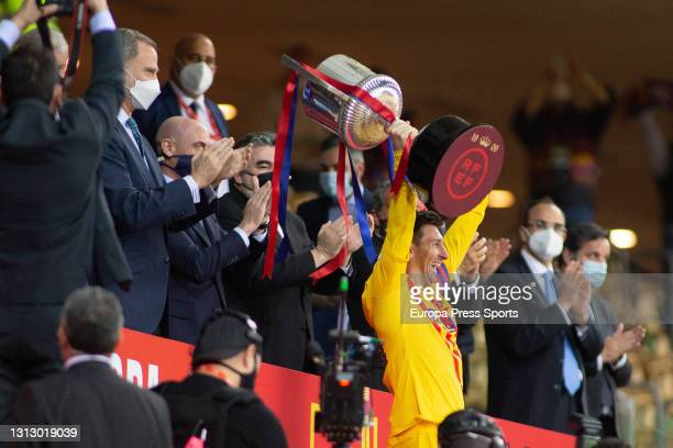 Felipe VI, King of Spain, give the trophy of Champions of the tournament to Lionel Messi of FC Barcelona after the spanish cup, Copa del Rey,...