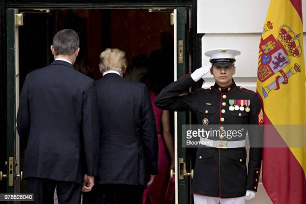 Felipe VI Spain's king left and US President Donald Trump walk into the South Portico of the White House in Washington DC US on Tuesday June 19 2018...