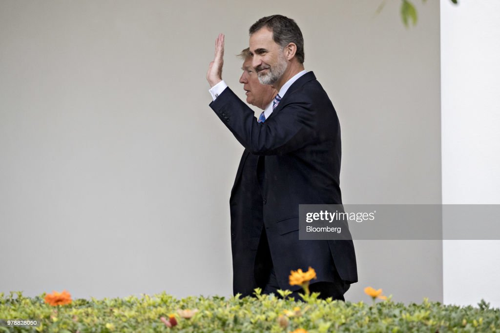Felipe VI, Spain's king, right, waves while walking with U.S. President Donald Trump through the Colonnade of the White House toward the Oval Office in Washington, D.C., U.S., on Tuesday, June 19, 2018. King Felipe and Queen Letizia are beginning a visit to the U.S., celebrating the 300th anniversaries of the founding of New Orleans and San Antonio. Photographer: Andrew Harrer/Bloomberg via Getty Images