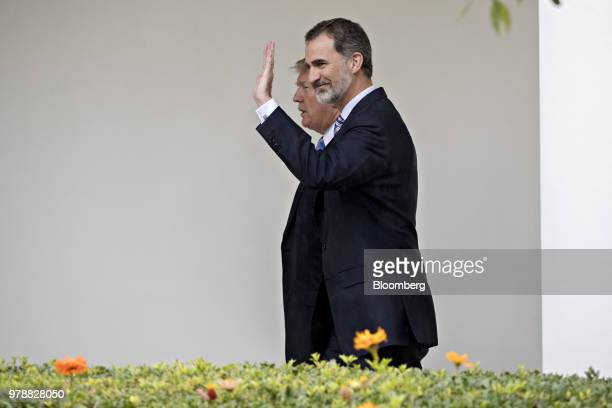 Felipe VI Spain's king right waves while walking with US President Donald Trump through the Colonnade of the White House toward the Oval Office in...