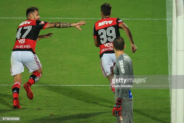 Felipe Vizeu and Lucas Paqueta of Flamengo celebrate a scored goal during a match between Flamengo and Santos as part of Brasileirao Series A 2017 at...