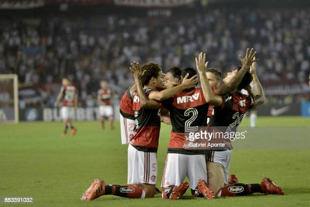 Felipe Vizeu of Flamengo celebrates with teammates after scoring the second goal of his team during a second leg match between Junior and Flamengo as...