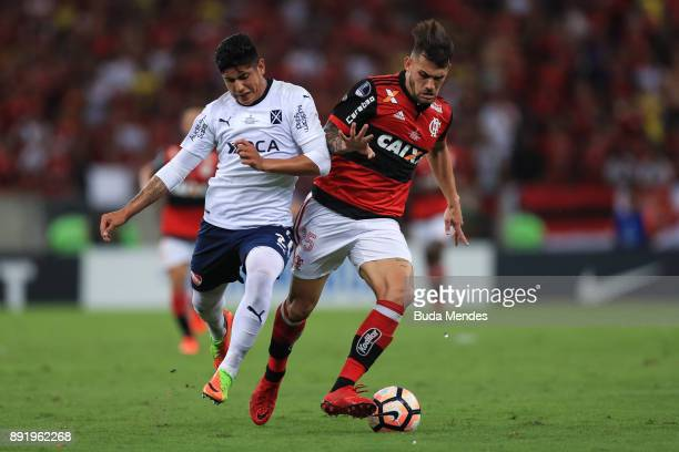 Felipe Vizeu of Flamengo struggles for the ball with Alan Franco of Independiente during the second leg of the Copa Sudamericana 2017 final between...