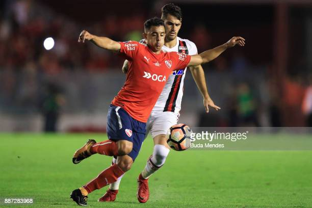 Felipe Vizeu of Flamengo struggles for the ball with Diego Rodriguez of Independiente during the first leg of the Copa Sudamericana 2017 final...