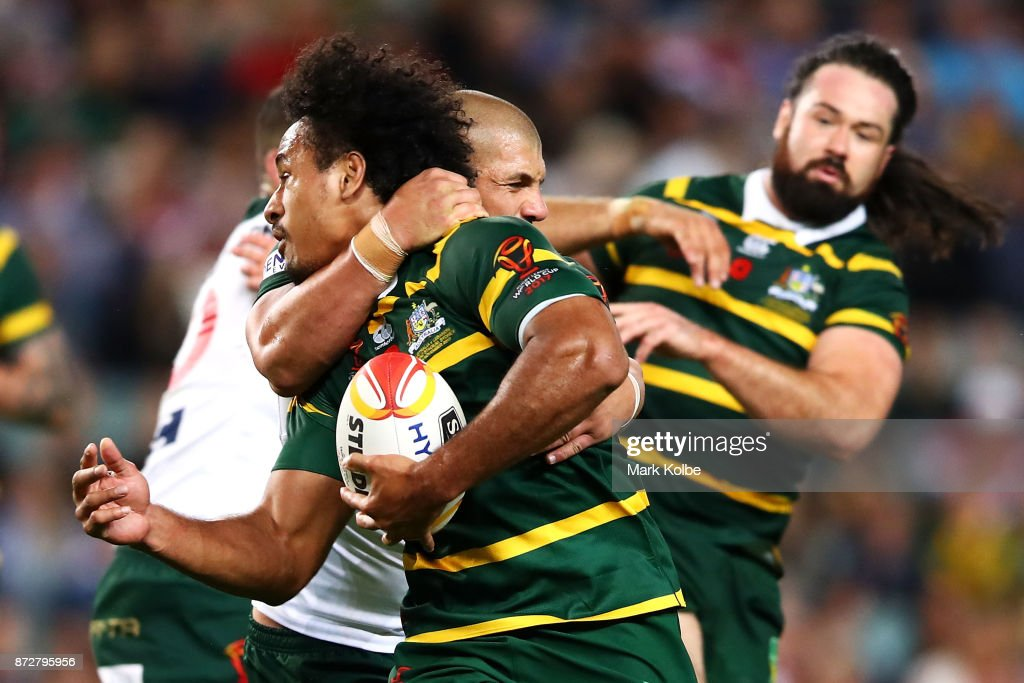 Felise Kaufusi of Australia is tackled high by Raymond Moujalli of Lebanon during the 2017 Rugby League World Cup match between Australia and Lebanon at Allianz Stadium on November 11, 2017 in Sydney, Australia.