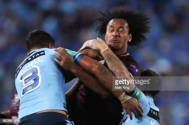 Felise Kaufusi of the Maroons is tackled during game two of the State of Origin series between the New South Wales Blues and the Queensland Maroons...