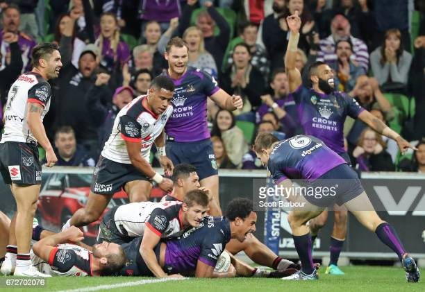 Felise Kaufusi of the Melbourne Storm scores a try as Josh AddoCarr celebrates during the round eight NRL match between the Melbourne Storm and the...