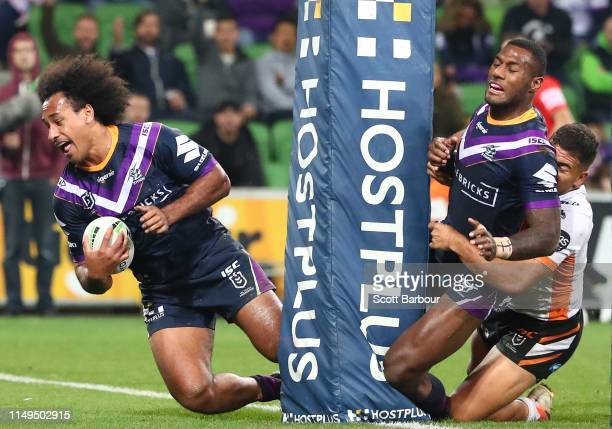 Felise Kaufusi of the Melbourne Storm scores a try during the round 10 NRL match between the Melbourne Storm and the Wests Tigers at AAMI Park on May...