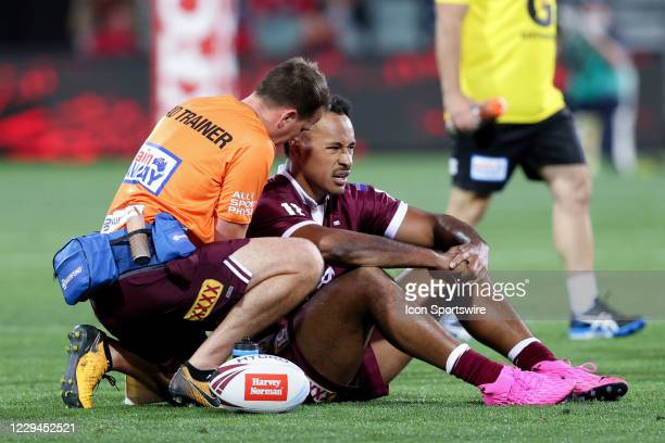 Felise Kaufusi of the QLD Maroons injured after a hard tackle during game one of the 2020 State of Origin series between the Queensland Maroons and...