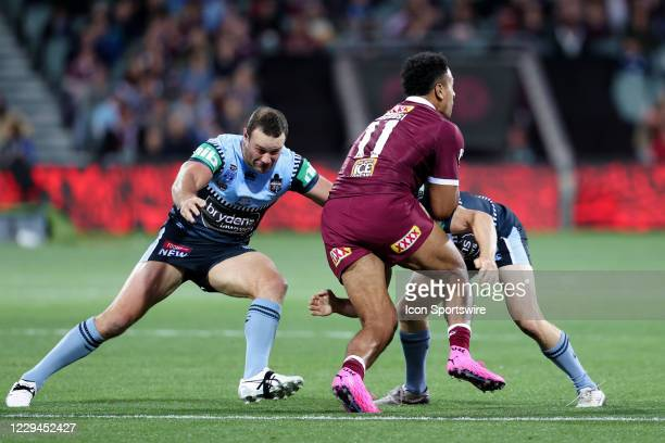Felise Kaufusi of the QLD Maroons is tackled hard during game one of the 2020 State of Origin series between the Queensland Maroons and New South...