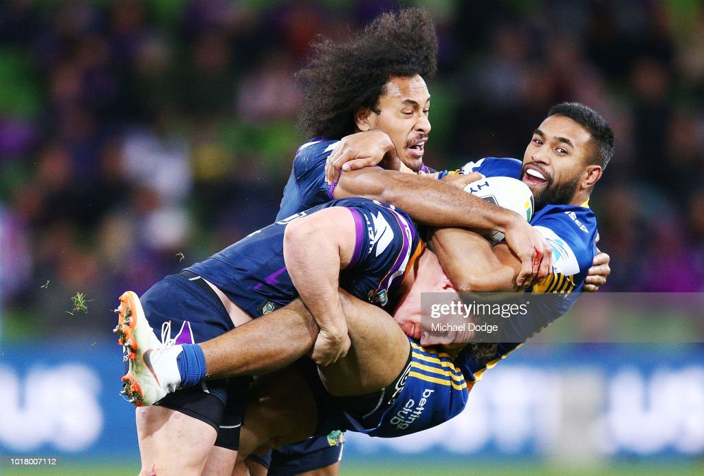 Felise Kaufusi of the Storm and Brodie Croft tackle George Jennings of the Eels during the round 23 NRL match between the Melbourne Storm and the Parramatta Eels at AAMI Park on August 17, 2018 in Melbourne, Australia.