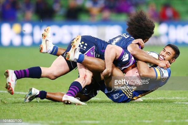 Felise Kaufusi of the Storm and Brodie Croft tackle George Jennings of the Eels during the round 23 NRL match between the Melbourne Storm and the...