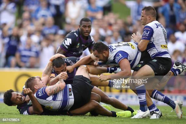 Felise Kaufusi of the Storm and Greg Eastwood of the Bulldogs attempt to break up a fight between Will Chambers of the Storm and Sam Kasiano of the...