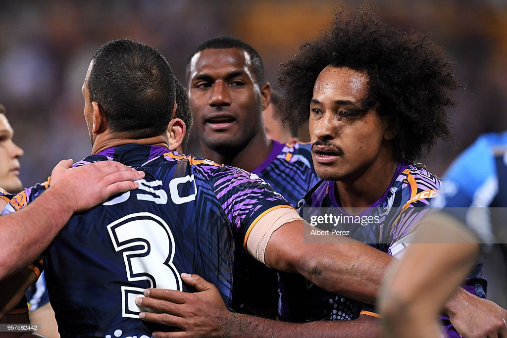 Felise Kaufusi of the Storm celebrates with team mates after scoring a try during the round ten NRL match between the Melbourne Storm and the Gold Coast Titans at Suncorp Stadium on May 12, 2018 in Brisbane, Australia.