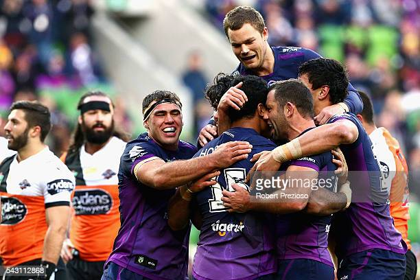 Felise Kaufusi of the Storm celebrates with teammates after crossing the line to score a try during the round 16 NRL match between the Melbourne...