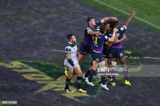 Felise Kaufusi of the Storm celebrates with teammates after scoring a try during the 2017 NRL Grand Final match between the Melbourne Storm and the...