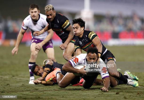 Felise Kaufusi of the Storm is tackled by Jarome Luai of the Panthers during the round six NRL match between the Penrith Panthers and the Melbourne...