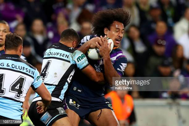 Felise Kaufusi of the Storm is tackled by the Sharks defence during the NRL Preliminary Final match between the Melbourne Storm and the Cronulla...