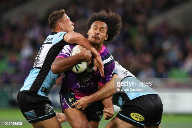 Felise Kaufusi of the Storm is tackled during the round 22 NRL match between the Melbourne Storm and the Cronulla Sharks at AAMI Park on August 12...