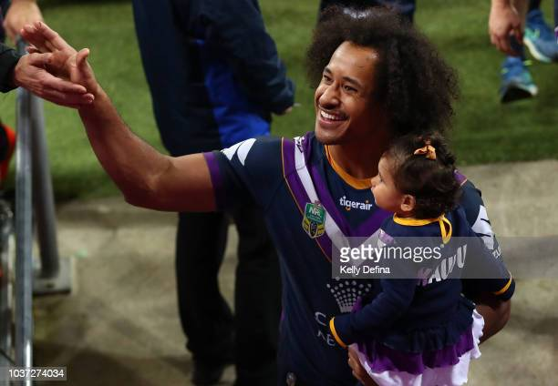 Felise Kaufusi of the Storm leaves the field with his daughter after the Storm win the NRL Preliminary Final match between the Melbourne Storm and...