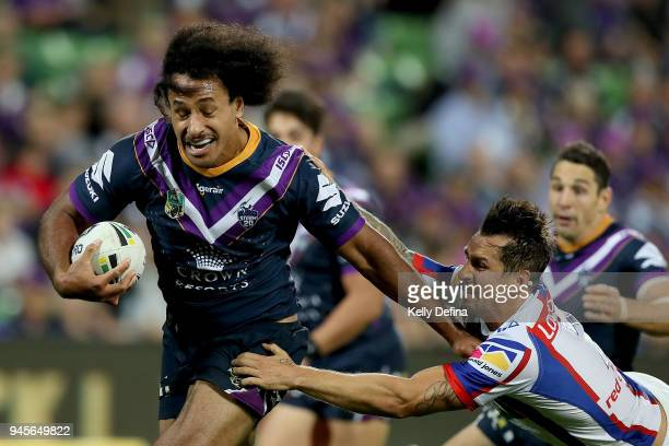 Felise Kaufusi of the Storm runs with the ball on the way to scoring a try during the round six NRL match between the Melbourne Storm and the...