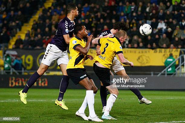 Felitciano Zschusschen and Henrico Drost of NAC battle for the header with Mawouna Kodjo Amevor and Bart Vriends of Go Ahead Eagles during the Dutch...