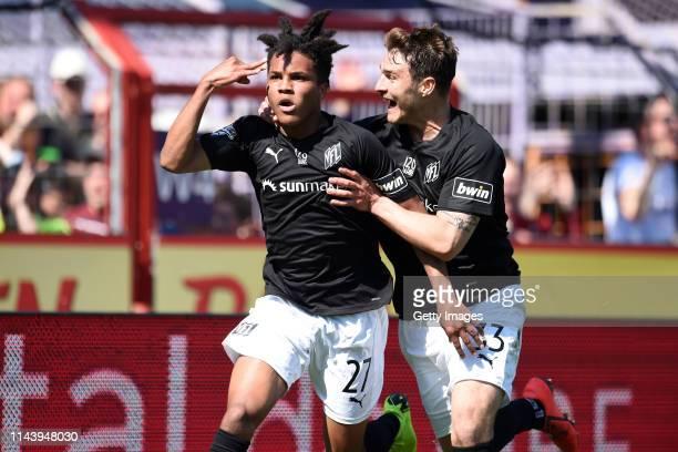 Felix Agu and Benjamin Girth of Osnabrueck celebrate during the 3 Liga match between VfL Osnabrueck and VfR Aalen at Stadion an der Bremer Brücke on...