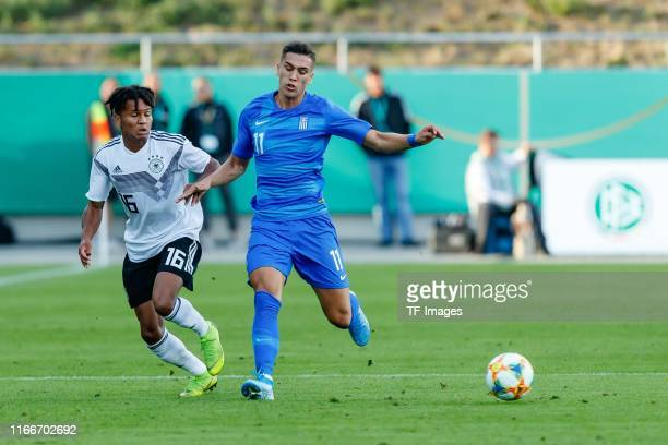 Felix Agu of Germany and Argyris Kampetsis of Greece battle for the ball during the U21 international friendly match between Germany and Greece at...
