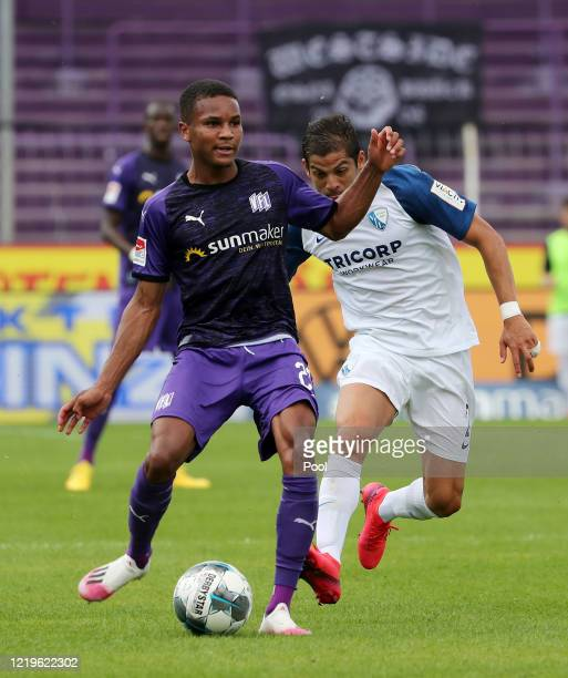 Felix Agu of Osnabruck in action against Cristian Gamboa of Bochum during the Second Bundesliga match between VfL Osnabrück and VfL Bochum 1848 at...