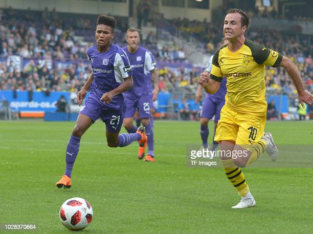 Felix Agu of Osnabrueck and Mario Goetze of Borussia Dortmund battle for the ball during the Frendly Match between VfL Osnabrück and Borussia...