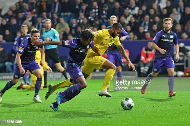 Felix Agu of Osnabrueck tackles Cebio Soukou of Bielefeld during the Second Bundesliga match between VfL Osnabrück and DSC Arminia Bielefeld at...