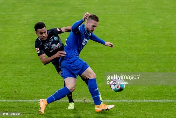 Felix Agu of SV Werder Bremen and Pavel Kaderabek of TSG 1899 Hoffenheim battle for the ball during the Bundesliga match between TSG Hoffenheim and...